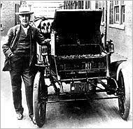 NY Times/Getty: Thomas Edison holding one of the batteries used to power his early electric car, the Baker