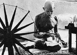 Ghandi using cotton wheel