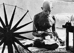 Ghandi using cotton wheel