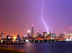 picture of lightning striking both Hancock AND Sears towers by Volkan Yuksel