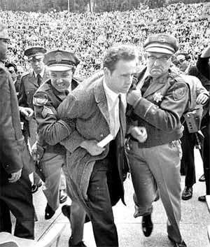 Police try to stop Mario Savio, leader of the Free Speech Movement from speaking at the Greek Theatre, in Berkeley, 1964.